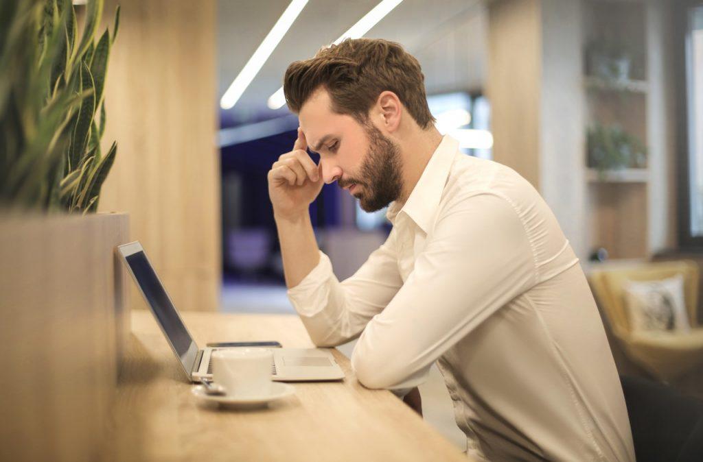 A man at work feeling sluggish
