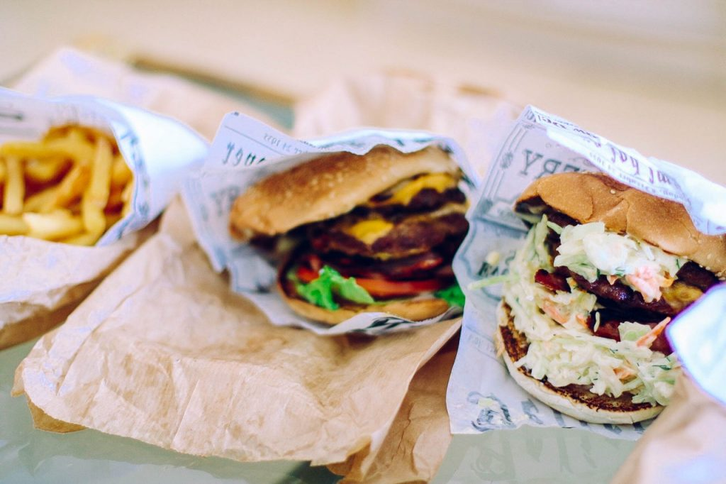 Two burgers with potato fries