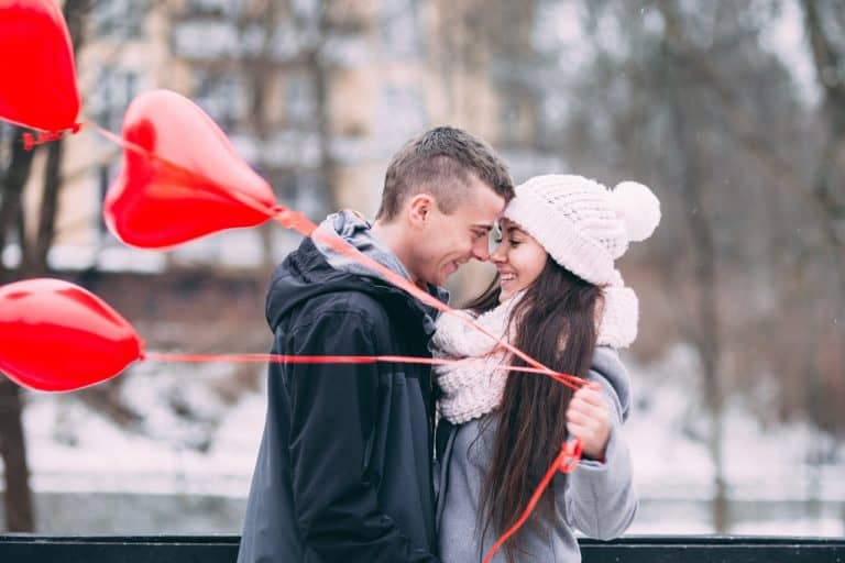Couple with love balloons