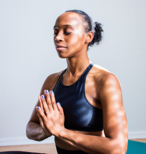 Fit woman in meditation