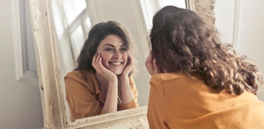 Woman facing a mirror