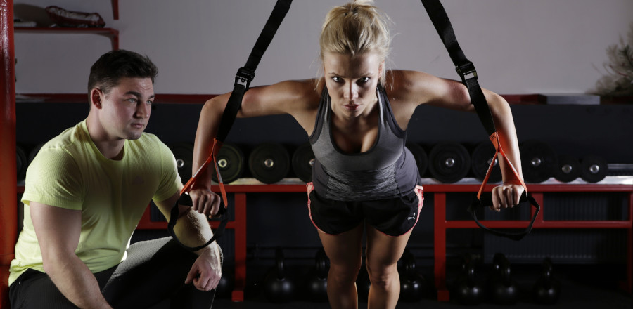 Woman working out with a trainer