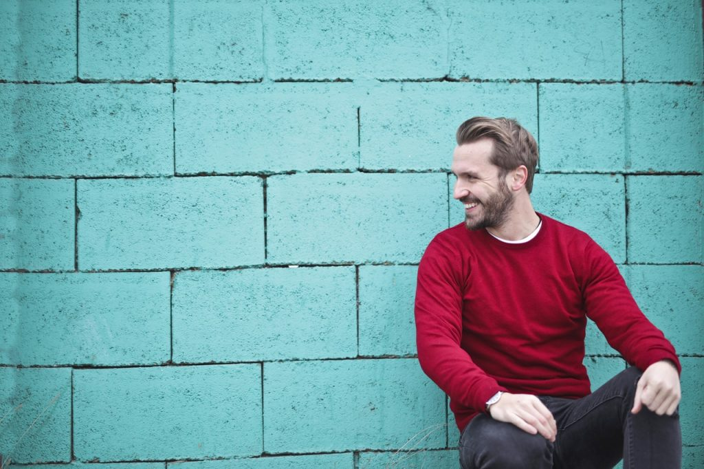 A happy man in red sweater