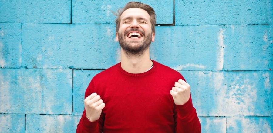Smiling guy feeling happy