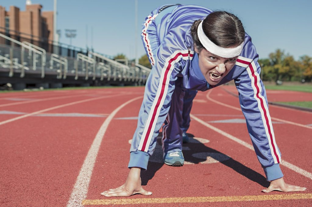 A woman starting off on the track field
