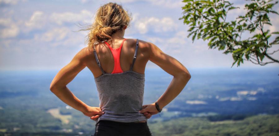 Runner on a hill top