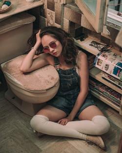 Woman beside the toilet bowl