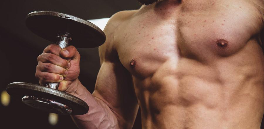 Muscular man holding a dumbbell