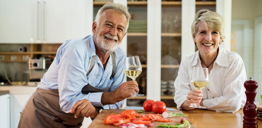 Old couple drinking wine
