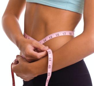 Slim woman using a tape measure