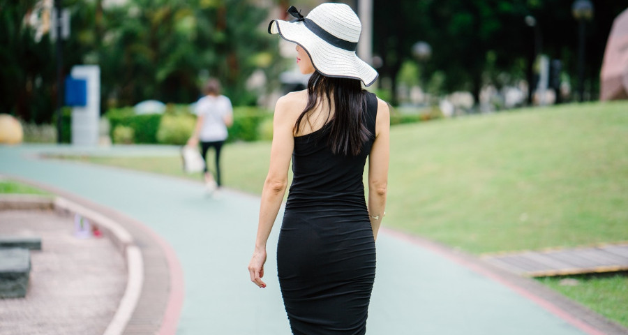 Slim woman in black outfit
