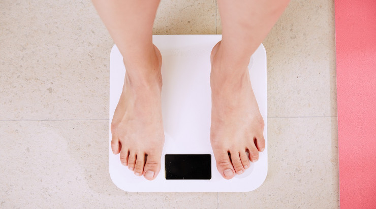A person on top of a weighing scale