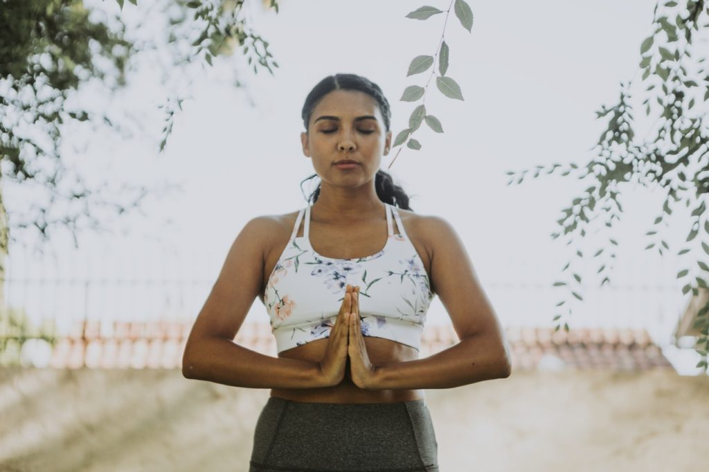 A woman doing peaceful exercise