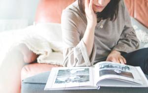 Woman browsing a photo album
