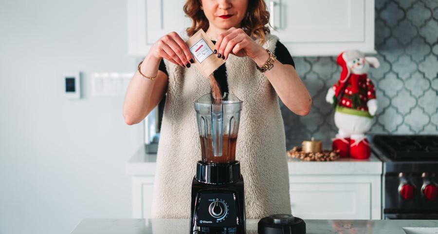 Woman mixing powder juices