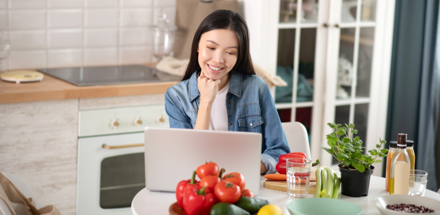 Woman using a laptop in the kitchen