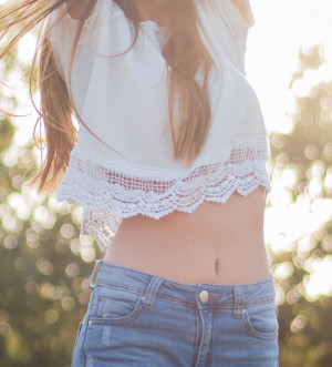 Woman wearing short top exposing her belly